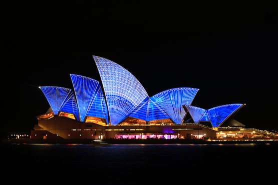 Sydney Opera House lit up in blue