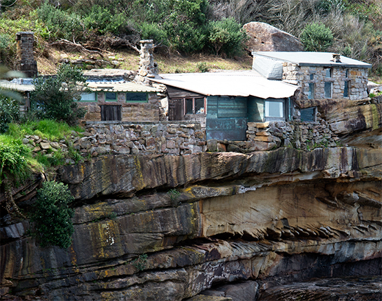 Stone huts on eastern side of Crater Cove, Sydney