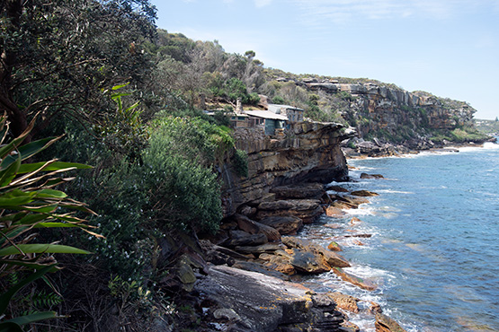 Crater Coves stone huts perch precariously on the clifftops of Dobroyd Head, Sydney