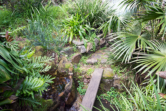 A rocky path has been created that connects the huts at Crater Cove, Sydney