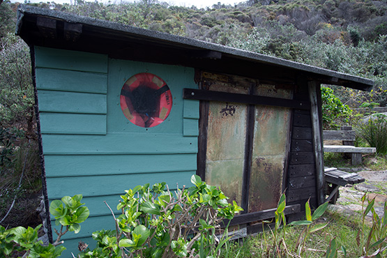 Rustic small wooden hut at Crater Cove, Sydney