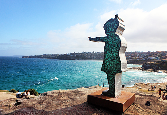 Girl Pointing, by Matt Calvert. at the Scupture by the Sea exhibition on the Bondi to Tamarama coastal walk, Sydney