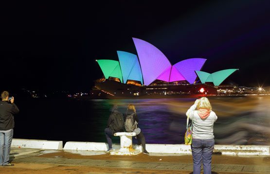Tourists take photos of the Sydney Opera House during the 2015 Vivid Sydney light festival